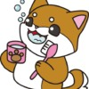 歯みがきをしている犬(茶色)イラスト