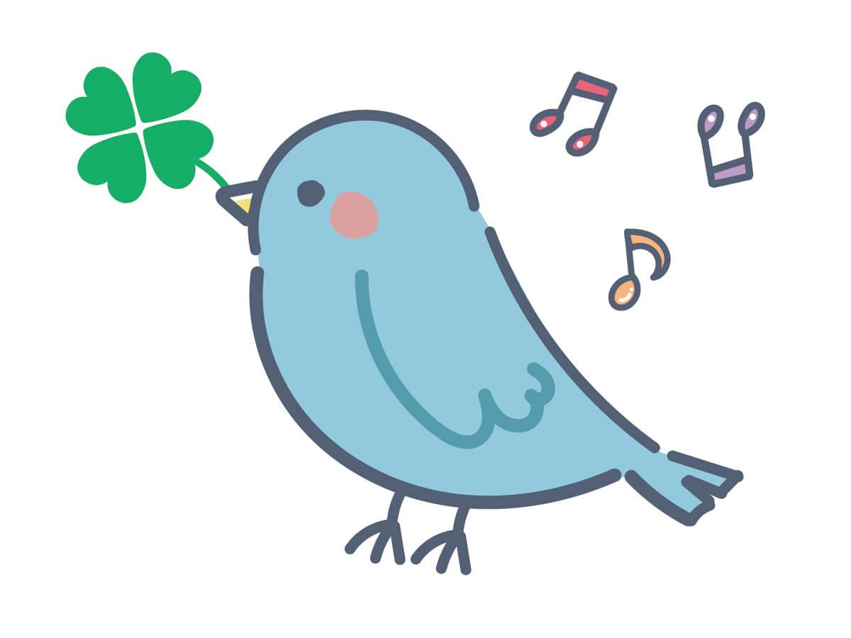 クローバーをくわえている「青い鳥」